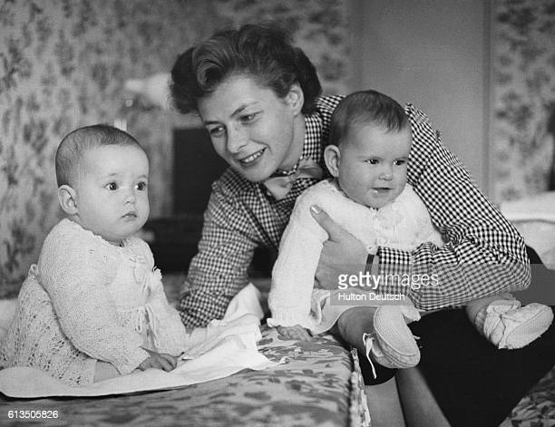 Swedish actress Ingrid Bergman with her twin daughters Isotta and Isabella in Naples Italy in 1953