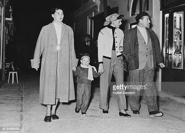 Swedish actress Ingrid Bergman with husband Italian film director Roberto Rossellini and son Robertino walking in Capri Italy in 1953
