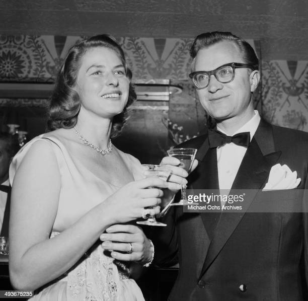 Swedish actress Ingrid Bergman with husband Lars Schmidt attends a party in Los Angeles California