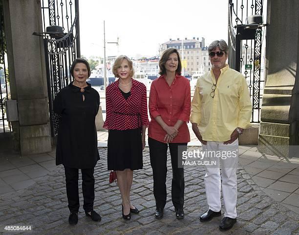 Swedish actress Ingrid Bergman's four children Isabella Rossellini, Pia Lindstrom, Ingrid Rossellini and Roberto Rossellini pose for photographers...