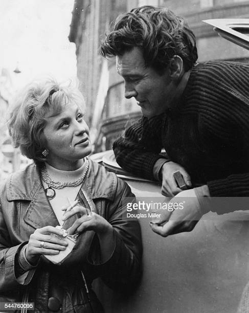 Swedish actress Mai Zetterling and her costar Terence Morgan chatting together on the set of the film 'Piccadilly Third Stop' in Knightsbridge London...