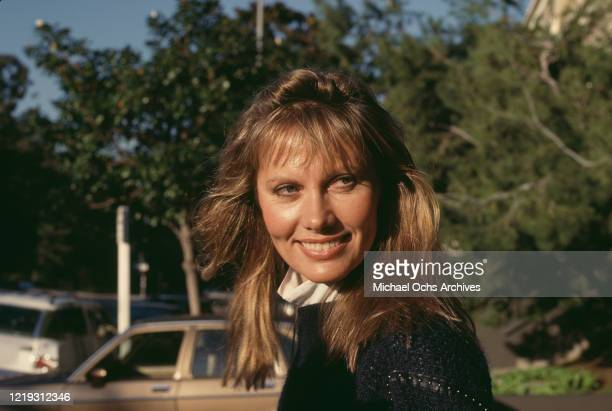 Swedish actress Maud Adams wearing a black woollen sweater circa 1985