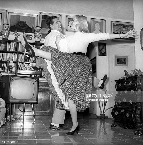 Swedish actress May Britt learning the Acrobatic Rock'n'Roll in her flat in Rome from her friend Salvatore Milizia who learned it during his last...