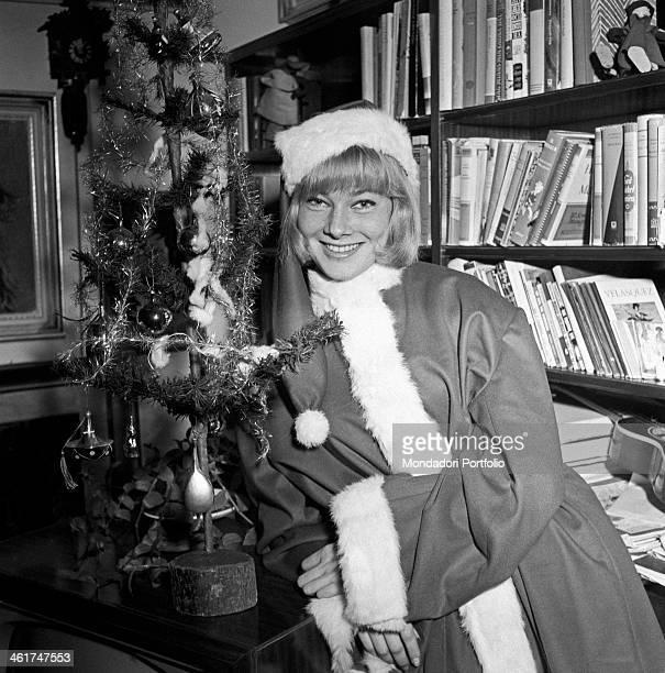 Swedish actress May Britt posing dressed as Santa Claus in her flat in Rome Rome 1956