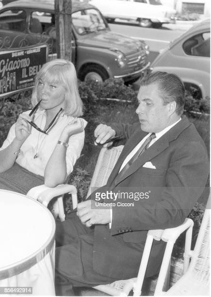 Swedish actress May Britt with actor John Mather in a cafe in Via Veneto Rome in 1958