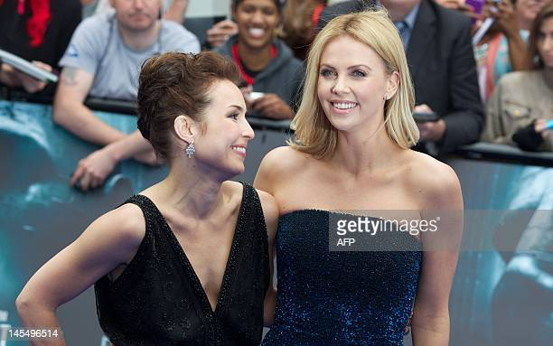 Swedish actress Noomi Rapace and South African actress Charlize Theron pose on the red carpet to attend the world premiere of the film 'Prometheus'...