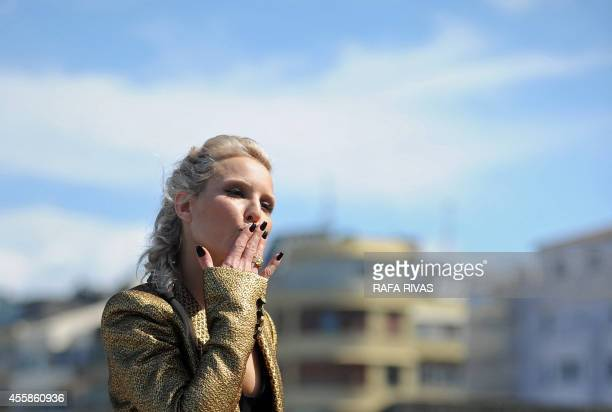 Swedish actress Noomi Rapace blows a kiss during a photocall after the screening of her film The Drop during the 62nd San Sebastian Film Festival on...
