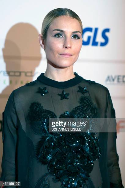 Swedish actress Noomi Rapace poses for photographers as she arrives at the 26th European Film Awards ceremony on December 7 2013 in Berlin Every year...