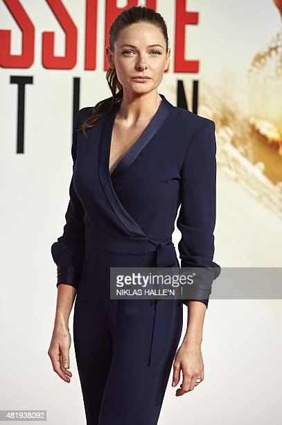 Swedish actress Rebecca Ferguson poses on the red carpet as she arrives for the premiere of 'Mission Impossible Rogue Nation' in London on July 25...