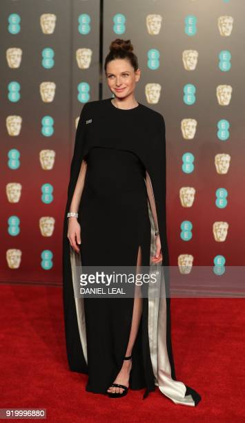 Swedish actress Rebecca Ferguson poses on the red carpet upon arrival at the BAFTA British Academy Film Awards at the Royal Albert Hall in London on...