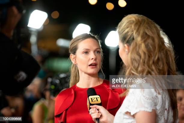 Swedish actress Rebecca Ferguson talks with a reporter on the red carpet prior to a screening of 'Mission Impossible Fallout' at the Smithsonian...
