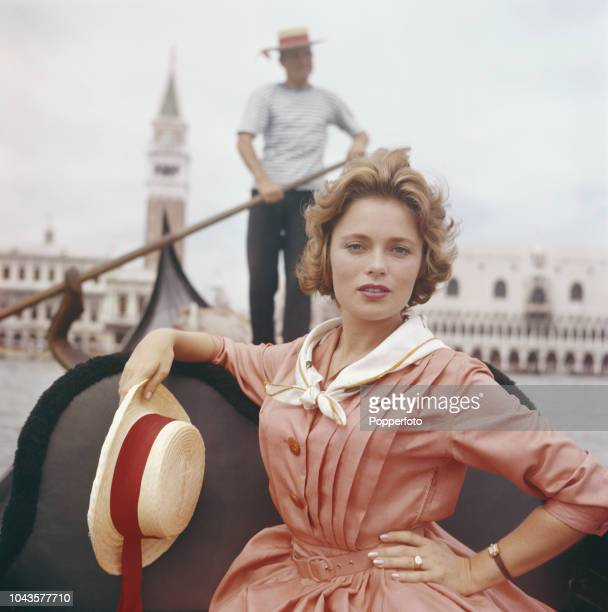 Swedish actress Ulla Jacobsson pictured seated in a gondola on the Grand Canal in front of the Doge's Palace during the 1960 Venice International...