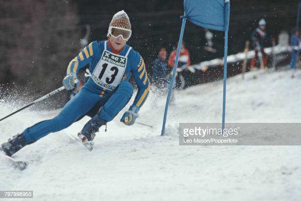 Swedish alpine ski racer Ingemar Stenmark competes to finish in first place to win the grand slalom event part of the 1979 Alpine Skiing World Cup at...