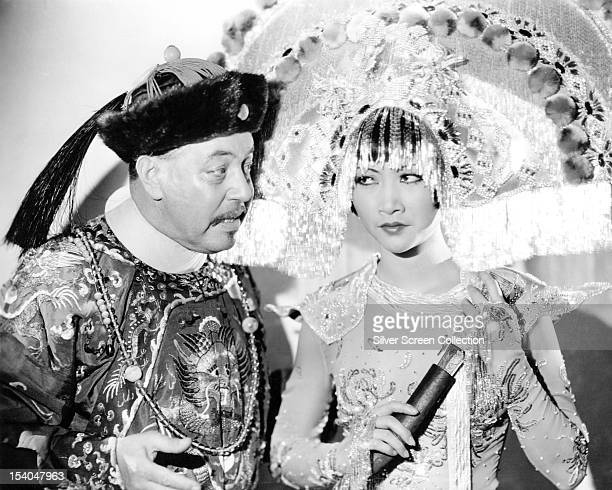 Swedish American actor Warner Oland as Dr Fu Manchu and American actress Anna May Wong as Princess Ling Moy in 'Daughter Of The Dragon' directed by...