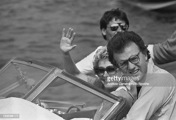 Swedish anchorwoman Pia Lindstrom with her husband Joseph Daly on a water taxi, in Venice for the 'Tribute to Ingrid' celebration, Lido, Venice, 1983.