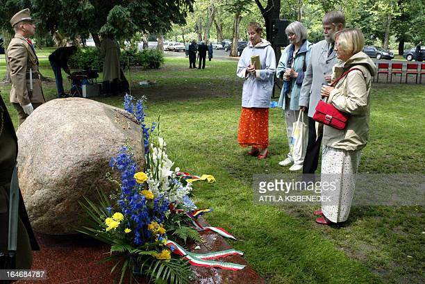 Swedish and Hungarian citizens stand gather at the 'Memorial stone' of former Swedish Foreign Minister Anna Lindh in the most famous public park of...