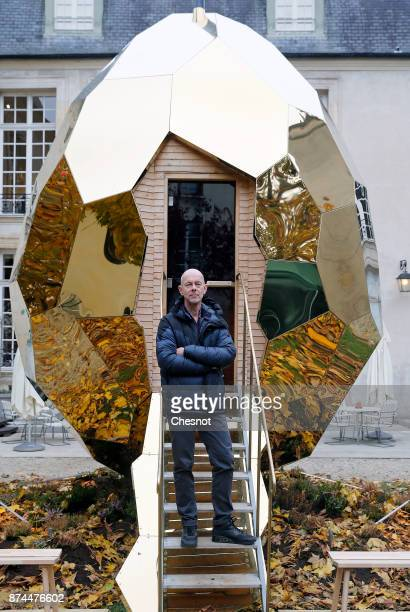 Swedish artist Mats Bigert poses in front of his public sauna art installation entitled 'Solar Egg' in the garden of the Swedish Institute in Paris...