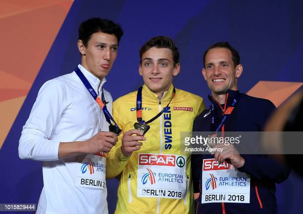 Swedish athlete Armand Duplantis Russian athlete Timur Murgunov and French athlete Renaud Lavillenie pose for a photo with their medals after winning...