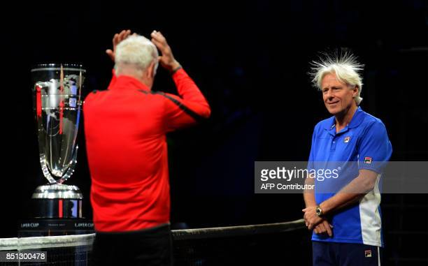 TOPSHOT Swedish Bjorn Borg captain of Team Europe and US John Mcenroe captain of Team World react during the line up at the start at the start of the...