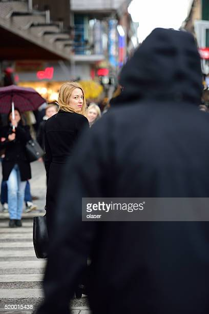swedish blonde woman, followed? - stalker person stock photos and pictures
