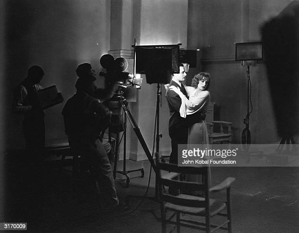 Swedish born American actress Greta Garbo and John Gilbert during the filming of 'A Woman of Affairs' The pair's onscreen passion reflects their...