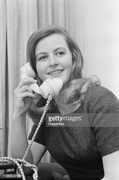 Swedish born journalist and broadcaster Pia Lindstrom, daughter of actress Ingrid Bergman, pictured making a telephone call in March 1964.