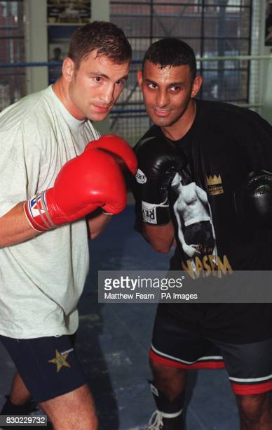 Swedish boxer Paolo Roberto and Britain's Prince Naseem Hamed after their sparring session at the Lennox Lewis Centre in London.