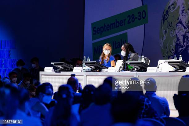Swedish climate activist Greta Thunberg and Vanessa Nakate attends the Youth4Climate Pre-COP Event at MiCo Convention Centre on September 28, 2021 in...