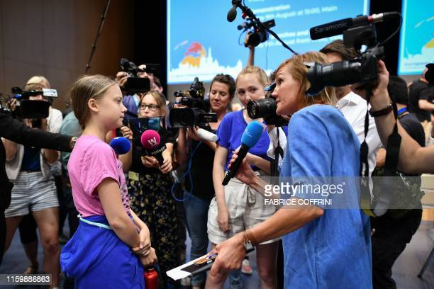 Swedish climate Activist Greta Thunberg answers the questions of a journalist following the opening press conference of the Smile for Future Summit...