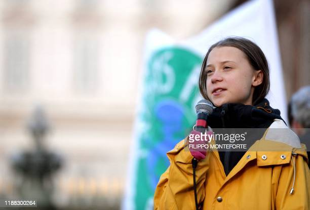 Swedish climate activist Greta Thunberg delivers a speech during the Friday for Future strike on climate emergency, in Turin, on December 13, 2019. -...
