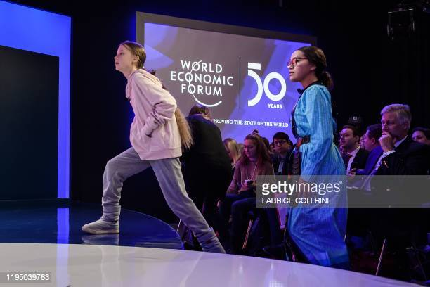 TOPSHOT Swedish climate activist Greta Thunberg followed by Canadian climate and environmental activist Autumn Peltier arrives to the Congres center...