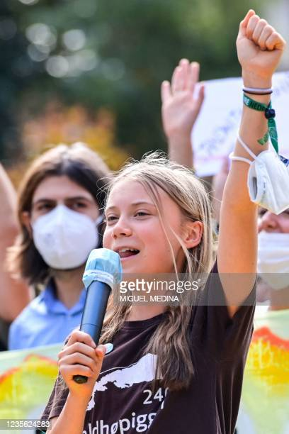Swedish climate activist Greta Thunberg gestures as she speaks during a Fridays for Future students' strike on October 1, 2021 on the sidelines of...