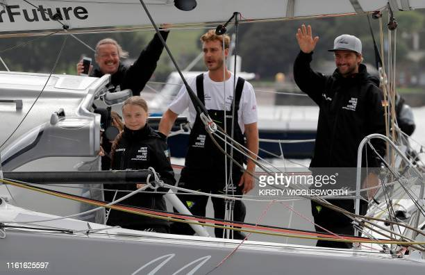 Swedish climate activist Greta Thunberg , her father Svante Thunberg , and skippers Pierre Casiraghi and Boris Herrmann wave from aboard the Malizia...