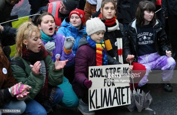 Swedish climate activist Greta Thunberg holds a banner as she takes part in a Youth Strike 4 Climate protest against global warming and climate...