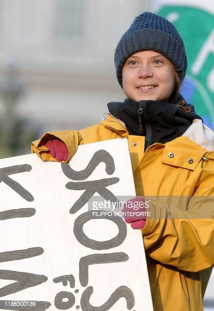 Swedish climate activist Greta Thunberg looks on as she takes part in the Friday for Future strike on climate emergency, in Turin, on December 13,...