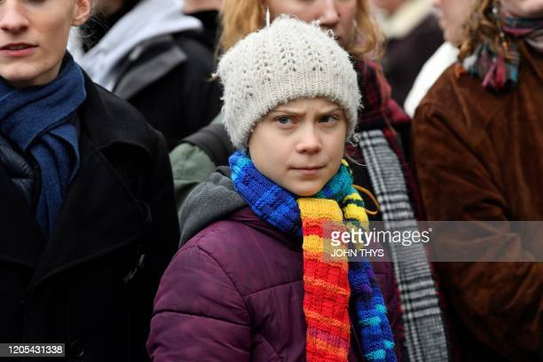 Swedish climate activist Greta Thunberg looks on as she takes part in a Youth Strike 4 Climate protest march on March 6 2020 in Brussels
