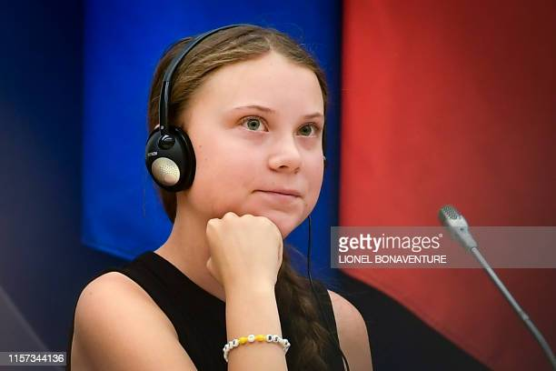 Swedish climate activist Greta Thunberg looks on before her speech during a meeting at the French National Assembly in Paris on July 23 2019