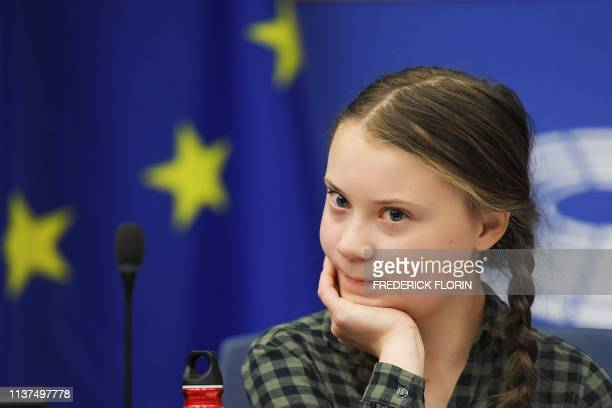 Swedish climate activist Greta Thunberg looks on during a debate with the EU Environment Public Health and Food Safety Committee during a session at...