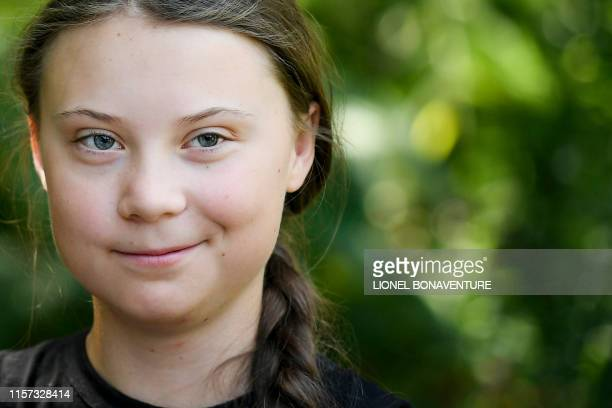 TOPSHOT Swedish climate activist Greta Thunberg looks on during a meeting in the garden of the Hotel de Lassay ahead of a visit of the French...
