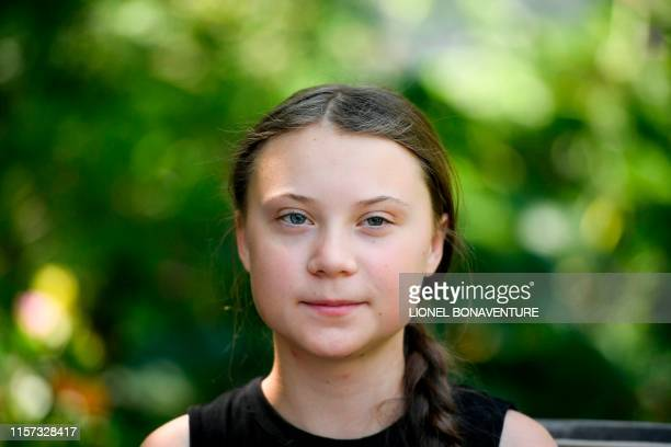 Swedish climate activist Greta Thunberg looks on during a meeting in the garden of the Hotel de Lassay ahead of a visit of the French National...
