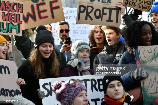 Swedish climate activist Greta Thunberg marches during a Friday for future youth demonstration in a street of Davos on January 24 2020 on the...