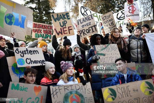 TOPSHOT Swedish climate activist Greta Thunberg marches during a Friday for future youth demonstration in a street of Davos on January 24 2020 on the...