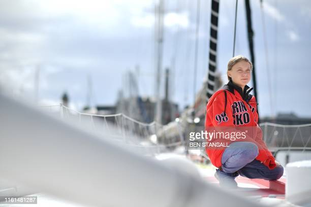 Swedish climate activist Greta Thunberg poses for a photograph during an inteview with AFP onboard the Malizia II sailing yacht at the Mayflower...