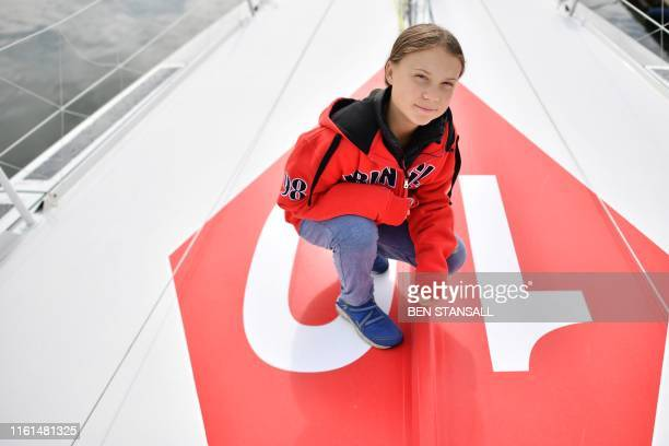 TOPSHOT Swedish climate activist Greta Thunberg poses for a photograph during an inteview with AFP onboard the Malizia II sailing yacht at the...