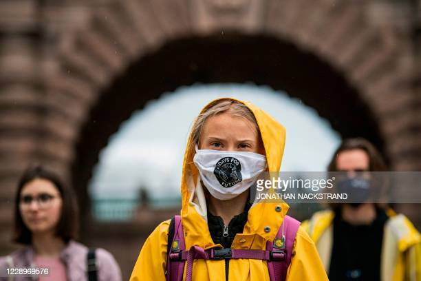 "Swedish climate activist Greta Thunberg protests during a ""Fridays for Future"" protest in front of the Swedish Parliament Riksdagen in Stockholm on..."