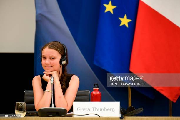 Swedish climate activist Greta Thunberg reacts after her speech during a meeting at the French National Assembly, in Paris, on July 23, 2019.