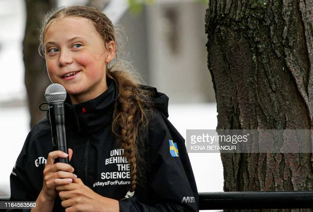 Swedish climate activist Greta Thunberg speaks after a 15day journey crossing the Atlantic on August 28 2019 in New York Greta Thunberg called on US...