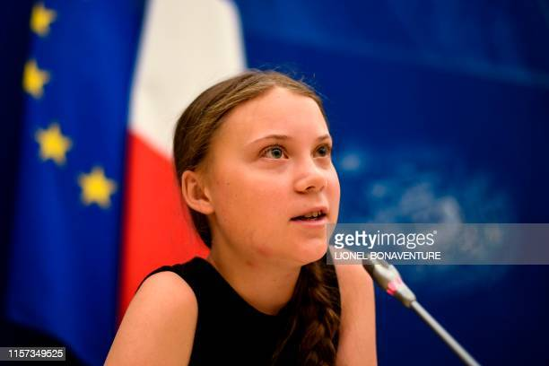 TOPSHOT Swedish climate activist Greta Thunberg speaks during a meeting at the French National Assembly in Paris on July 23 2019