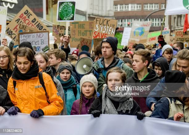Swedish climate activist Greta Thunberg takes part in a demonstration of students calling for climate protection on March 1 2019 in front of the...