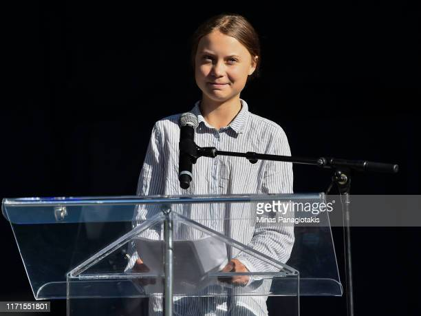 Swedish climate activist Greta Thunberg takes to the podium to address young activists and their supporters during the rally for action on climate...